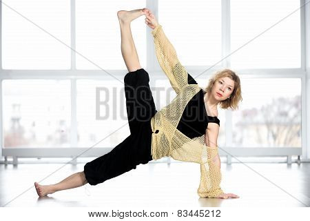 Middle Aged Yogi Female In Yoga Side Plank Pose