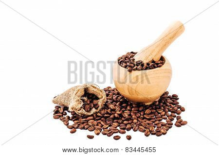 Coffee beans in wooden bamboo mortar isolated on white background. coffee beans isolated on white ba