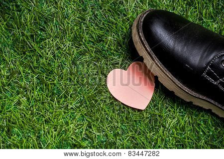 Heart Lying On The Grass Tramled By Big Black Boots