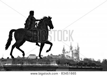 Equestrian statue of Louis XIV and the Basilica of Notre Dame de Fourviere on a background