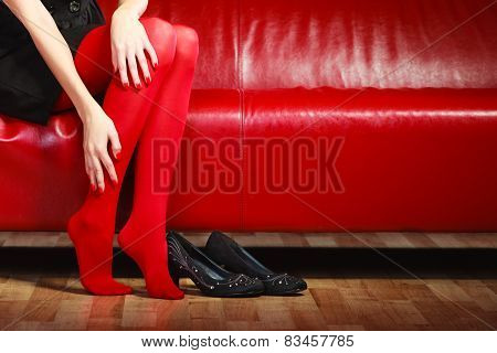 Fashion Woman Legs Red Pantyhose On Couch