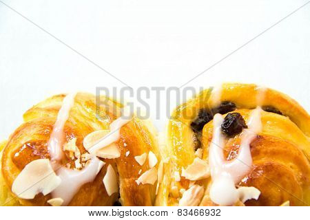 Raisin Cream Roll Danish And Almond Slice.
