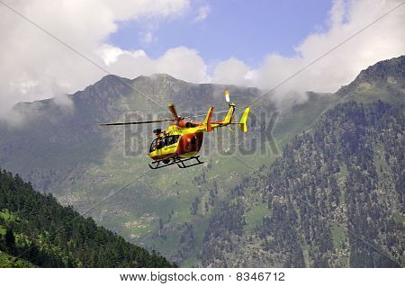 Rescue Helicopter In The Mountains