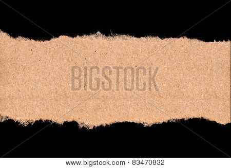 Piece Of Torn Kraft Paper On A Black Background