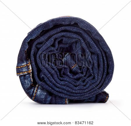 Roll Dark Blue Jeans On A White Background