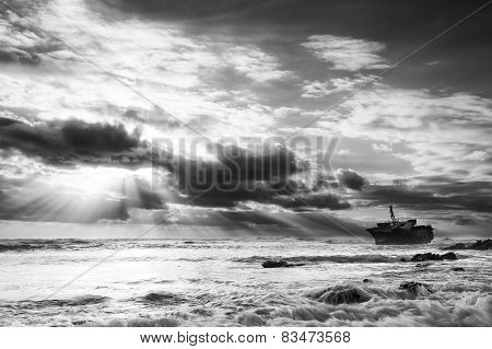 Old Shipwreck On Rocks At Sunset With Dramatic Sun Breaking Through Clouds Artistic Conversion