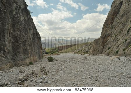 Taurus Mountains. Turkey. Steep Cliffs And Gorge. Snow-capped Peaks.