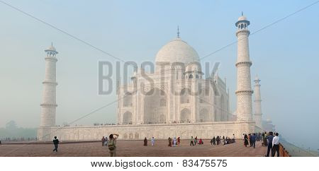 Agra, India - Circa Nov 2012: Tourists In Front Of The Taj Mahal. Usual Weather With Fog