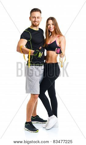 Happy Athletic Couple - Man And Woman With Measuring Tape On And Ginger Up The White