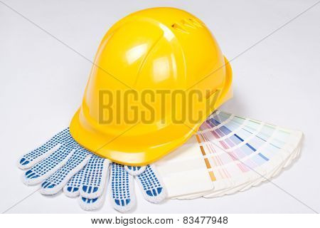 Yellow Helmet, Work Gloves And Colorful Palette Over White