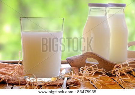 Glass Of Milk On A Table On The Field Front View