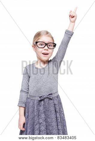 Beautiful Little Girl In Glasses Showing On Something By Finger