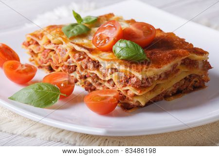 Italian Lasagna With Fresh Basil On A Plate. Horizontal