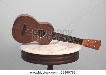 Ukulele Acoustic on Antique Marble Table