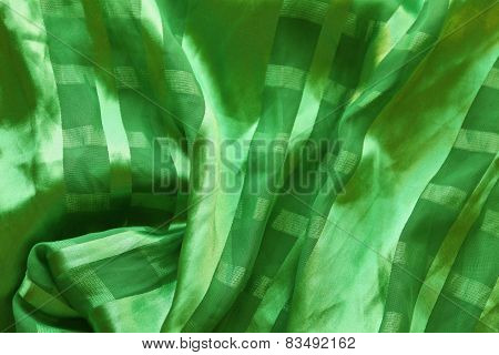 Texture Of Silk Green Fabric With Pleats