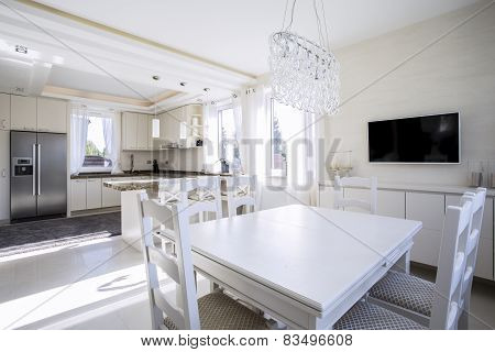 White Light Dining Area And Kitchen