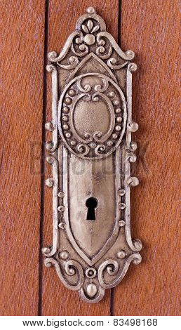 Keyhole With Ornament On Wooden Door