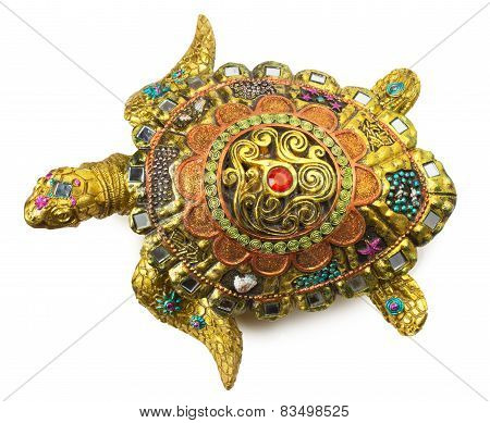 Turtle Statuette With Gemstones Isolated On The White Background