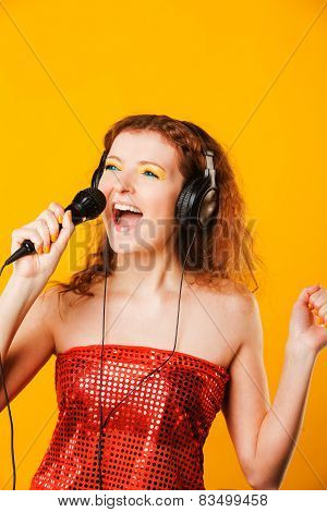Young happy woman with microphone. Singer. Karaoke