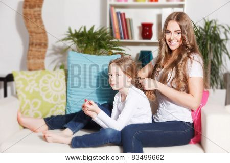 Mother Doing Daughter's Hairdo