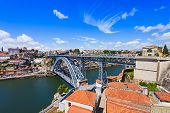 stock photo of dom  - The Dom Luis I Bridge is a metal arch bridge that spans the Douro River between the cities of Porto and Vila Nova de Gaia Portugal - JPG