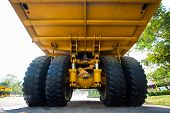 stock photo of trucks  - Heavy mining truck in mine and driving along the opencast - JPG