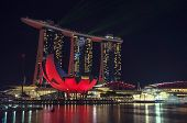 picture of singapore night  - Singapore skyline at night - Marina Bay with modern buildings and water.