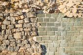 picture of rebuilt  - Rebuilt layers of an old wall on an archeological site