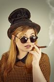 stock photo of mad hatter  - Tramp girl wears old top hat in vintage photo style
