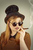 pic of tramp  - Tramp girl wears old top hat in vintage photo style  - JPG