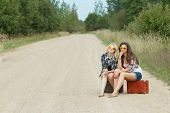 foto of country girl  - Student girls wearing sunglasses on a country road - JPG