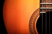 foto of acoustic guitar  - Color detail of an old acoustic guitar - JPG