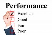 stock photo of performance evaluation  - Performance evaluation form tick excellent by businessman - JPG