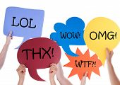 picture of lol  - Many Hands Holding Colorful Speech Balloons Or Speech Bubbles With Lol Wow Omg Thx Wtf Isolated On White - JPG