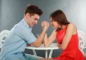 picture of wrestling  - Young happy couple challenge fighting in arm - JPG