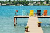 quite dock with colorful chairs and decorations