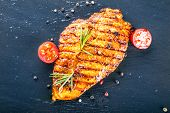 stock photo of chicken  - Steak chicken breast olive oil cherry tomatoes pepper and rosemary herbs - JPG