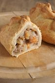 stock photo of rutabaga  - Traditional Cornish pasty filled with meat potato swede and carrots - JPG