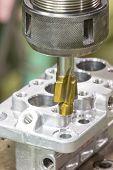stock photo of machine  - operator machining aluminium automotive parts by high precision machining center - JPG