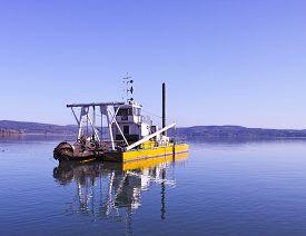 picture of dredge  - new yellow dredging boat on trasimeno lake - JPG