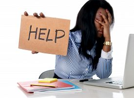 stock photo of secretary  - black African American ethnicity tired and frustrated woman working as secretary in stress at work office desk with computer laptop asking for help in business frustration concept - JPG