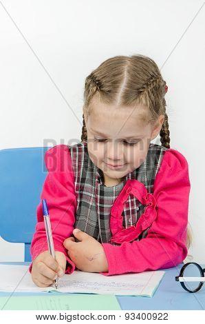 Schoolgirl Wrote In A Notebook