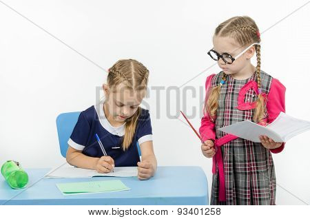 Privlezhnaya Pupil Under The Supervision Of A Strict Teacher