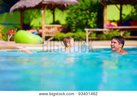 Happy Father And Son Having Fun In Pool Water, Summer Holiday