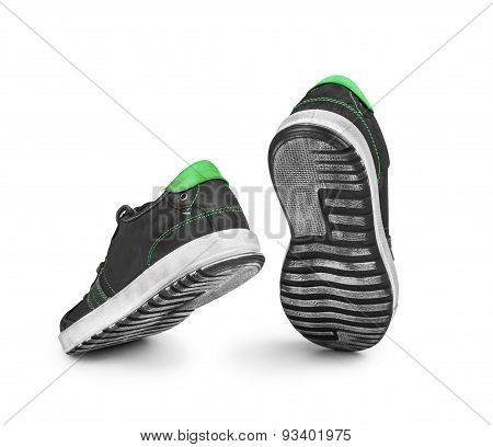 Black Sneakers Jumping On An Isolated White Background