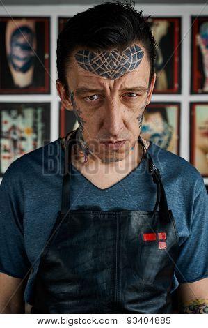 Freaky Tattooed Man In Studio