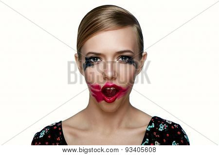 Beauty Female Model With Smeared Red Lipstick On Open Mouth.