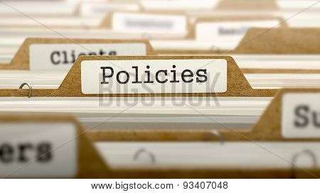 Policies Concept with Word on Folder.