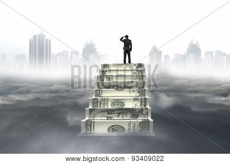 Business Man On Top Of Money Stairs Looking Cityscape Cloudscape