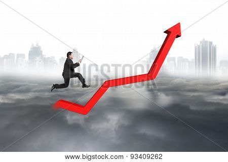 Business Man Holding Tablet Jumping On Red Growth Trend Line
